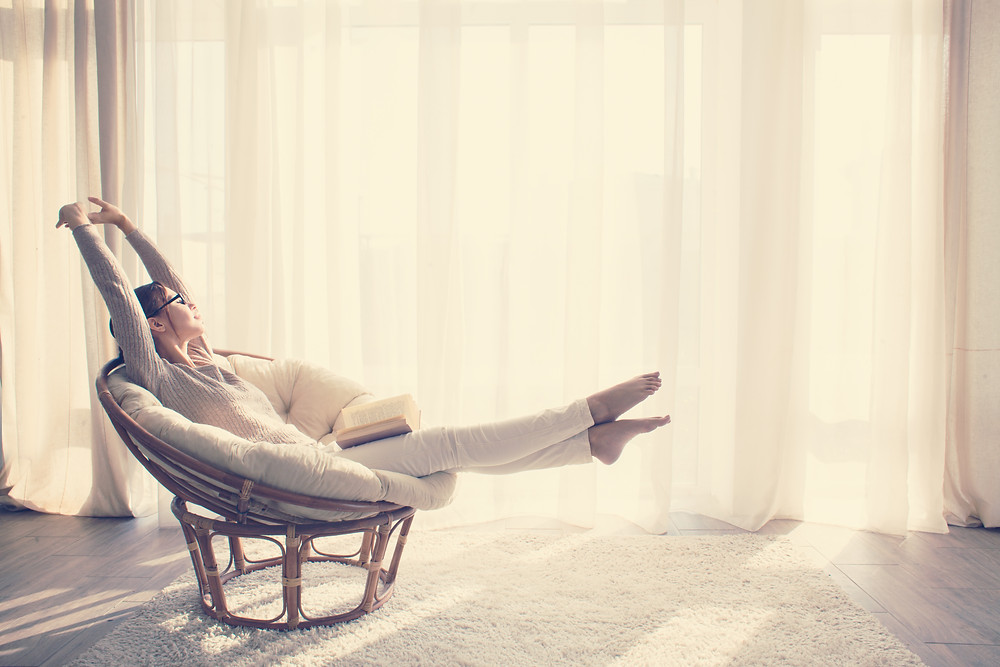 Relaxing woman in a nice chair with a book