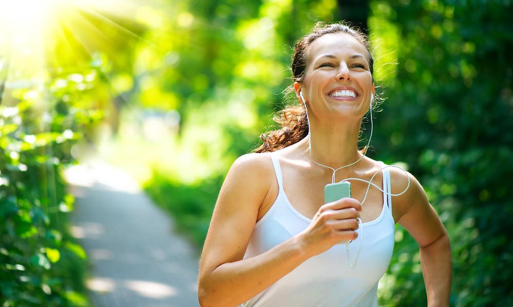 Happy woman running in the sun