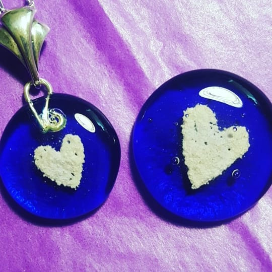Blue  pendant and touchstone memorials.j