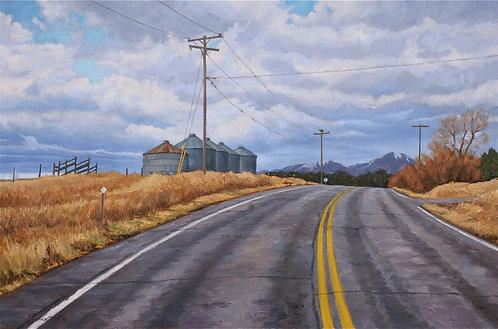 Black Top Road with Grain Bins