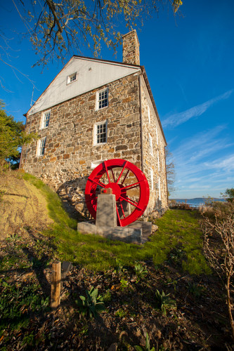 Restored Grist Mill with interpreted design of the historic Grist Mill and water wheel.
