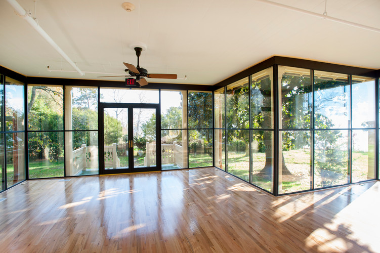 New glass enclosed porch.