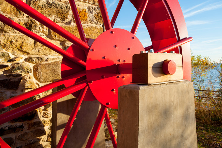 New water wheel using steel structural elements powder coated red.