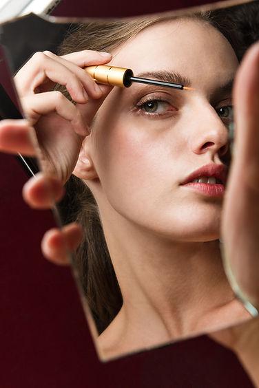 women using eyelash growth serum