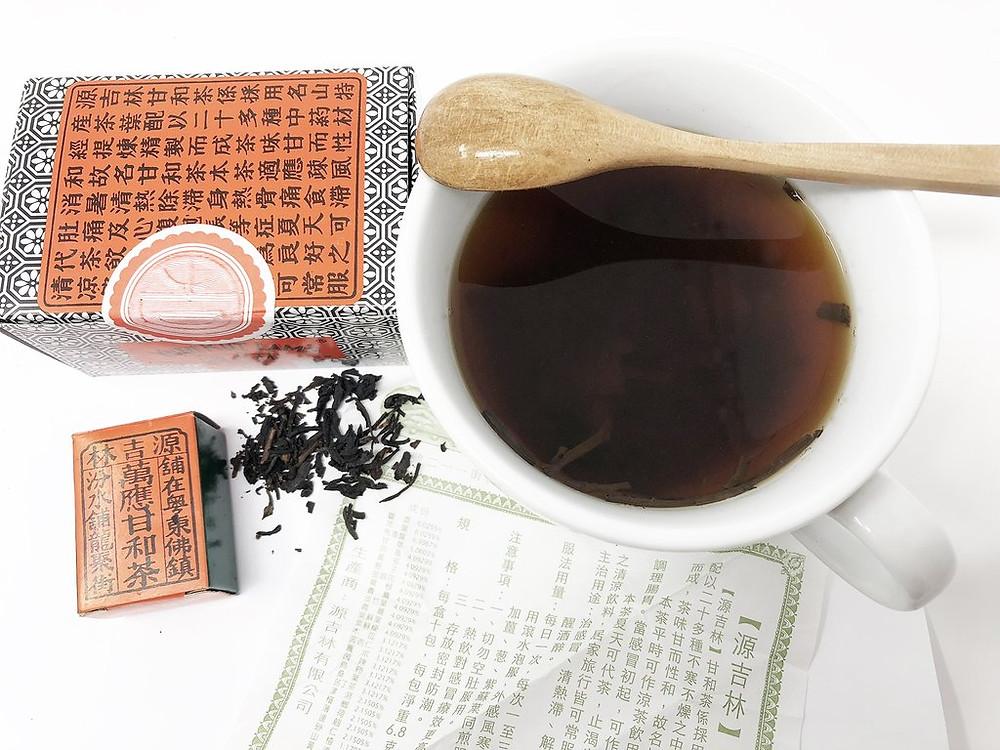 herbal tea, tea diffuser, contents of yuen kut lam tea, healthy black tea in cup