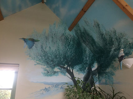 Large olive tree mural with birds in private house
