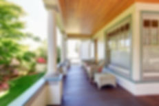 Front Porch With Chairs And Columns Of Craftsman Home..jpg