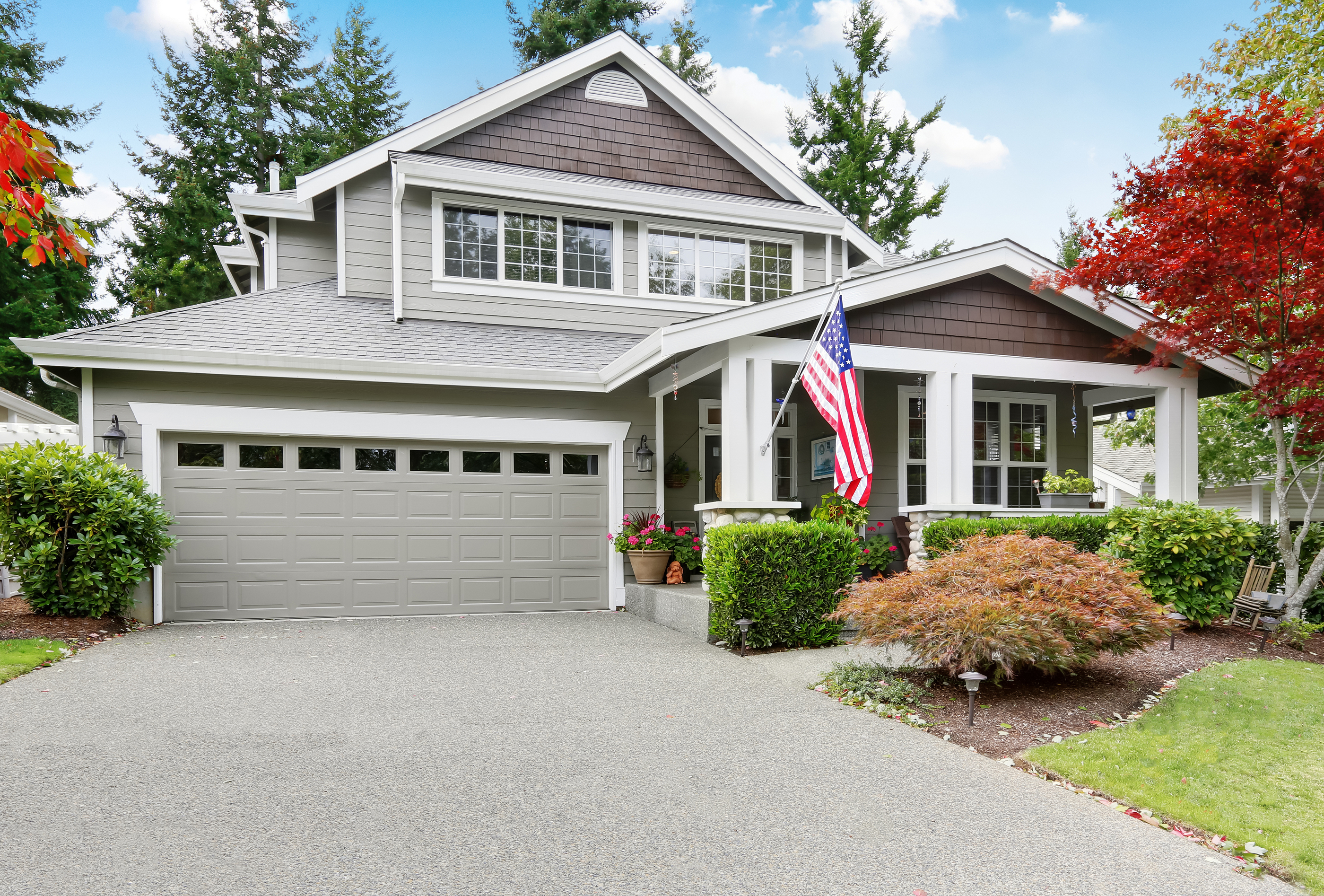 Nice Curb Appeal Of Grey House With Covered Porch And Garage.jpg