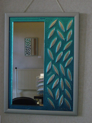 Pierced and fused glass mirror