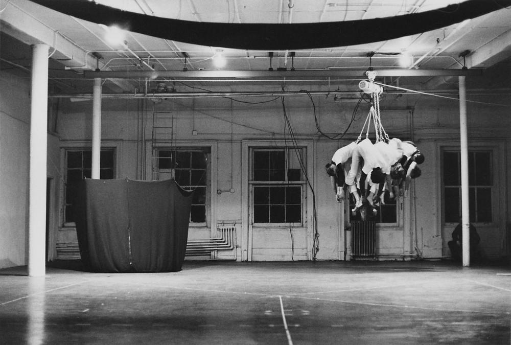 "Babette Mangolte, ""Sylvia Whitman 'Sling Shot' at Idea Warehouse 1975"", 1975. B&W Vintage Silver Gelatin print, 11 x 14 inches. ©Babette Mangolte"