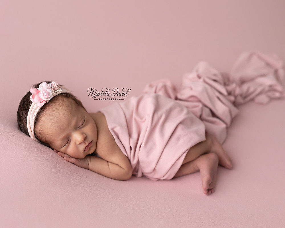 Sweet baby girl Ellie- Newborn Photographer Atlanta - baby girl in pink wearing a delicate pink flower headband