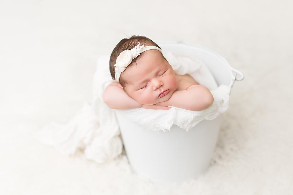 newborn baby in white bucket CALIFORNIA NEWBORN PHOTOGRAPHER