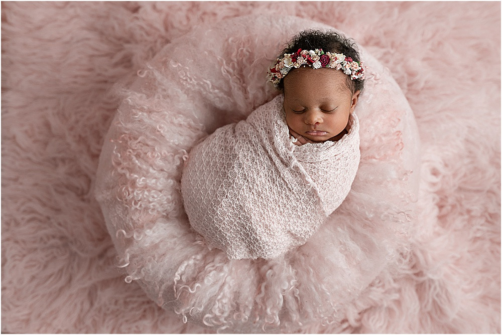 Newborn baby girl in pink with floral crown