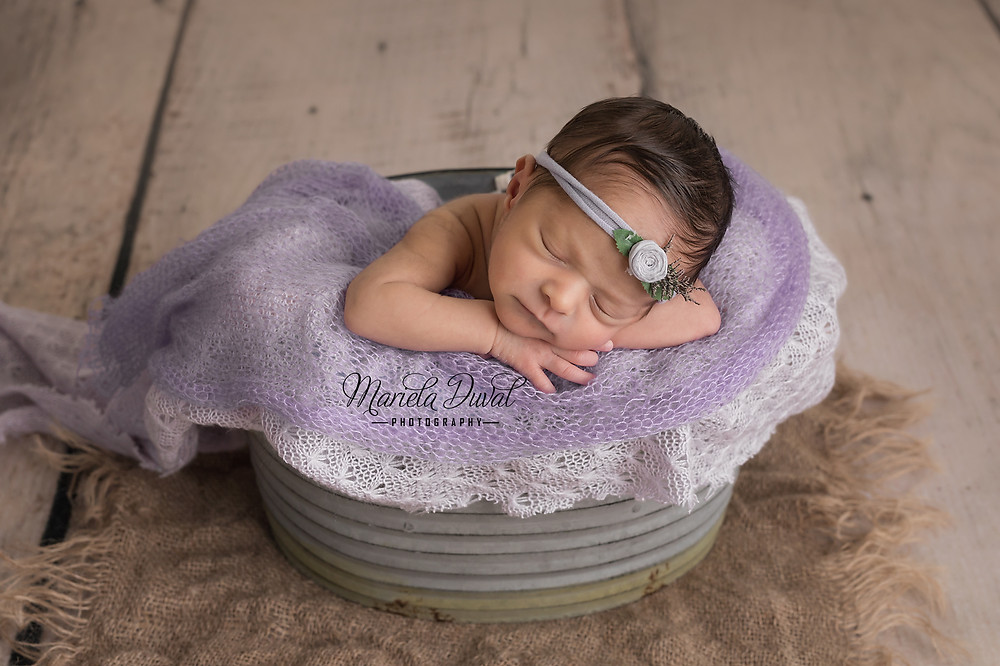 Sweet baby girl Ellie- Newborn Photographer Atlanta - baby girl in a bucket wearing lilac / lavender headband