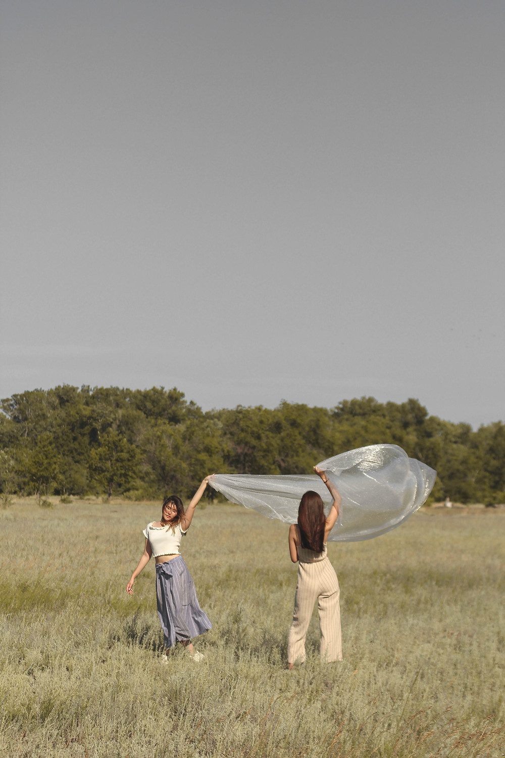 Two women with plastic sheet
