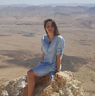 Woman Sitting on Mountain in Negev Desert