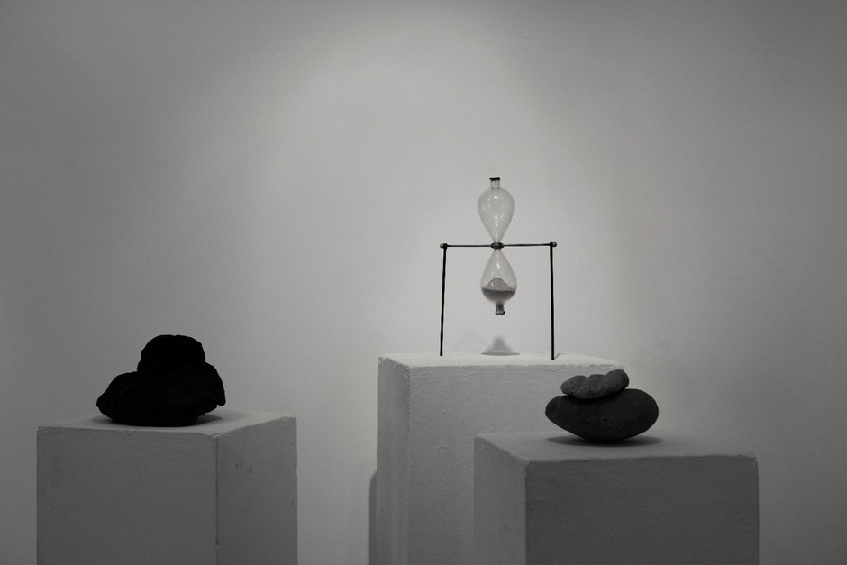 "Lea Jazbec. The Reflection. Installation view. Trzic museum. Solo exhibition. ""Time Titan"".  Hourglass Filled with dust, of broken mirror, Stones & Sack with the remains of mirror inside.  2012"