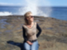 Vicki sitting at ocean cliff.jpg