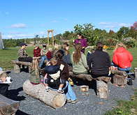 group of people learning in garden, outdoor classroom