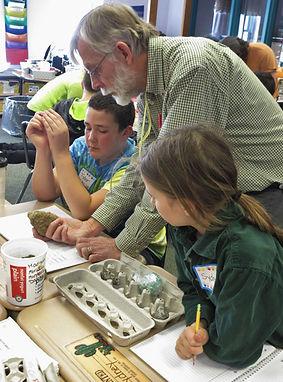 volunteer teaching students about geology