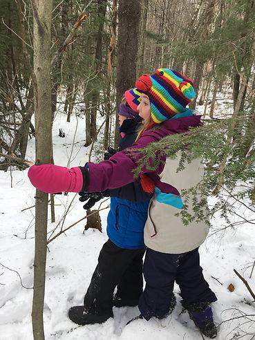 children outside in snow learning