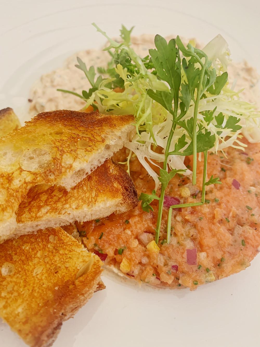king salmon tartare preserved meyer lemon, pepper cress, frisée, smoked paprika tzatziki, crostini
