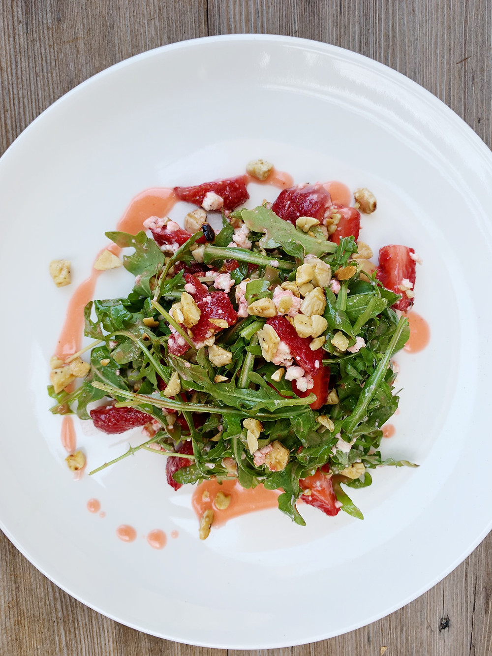 local strawberry salad arugula, french feta, toasted almonds, strawberry vinaigrette