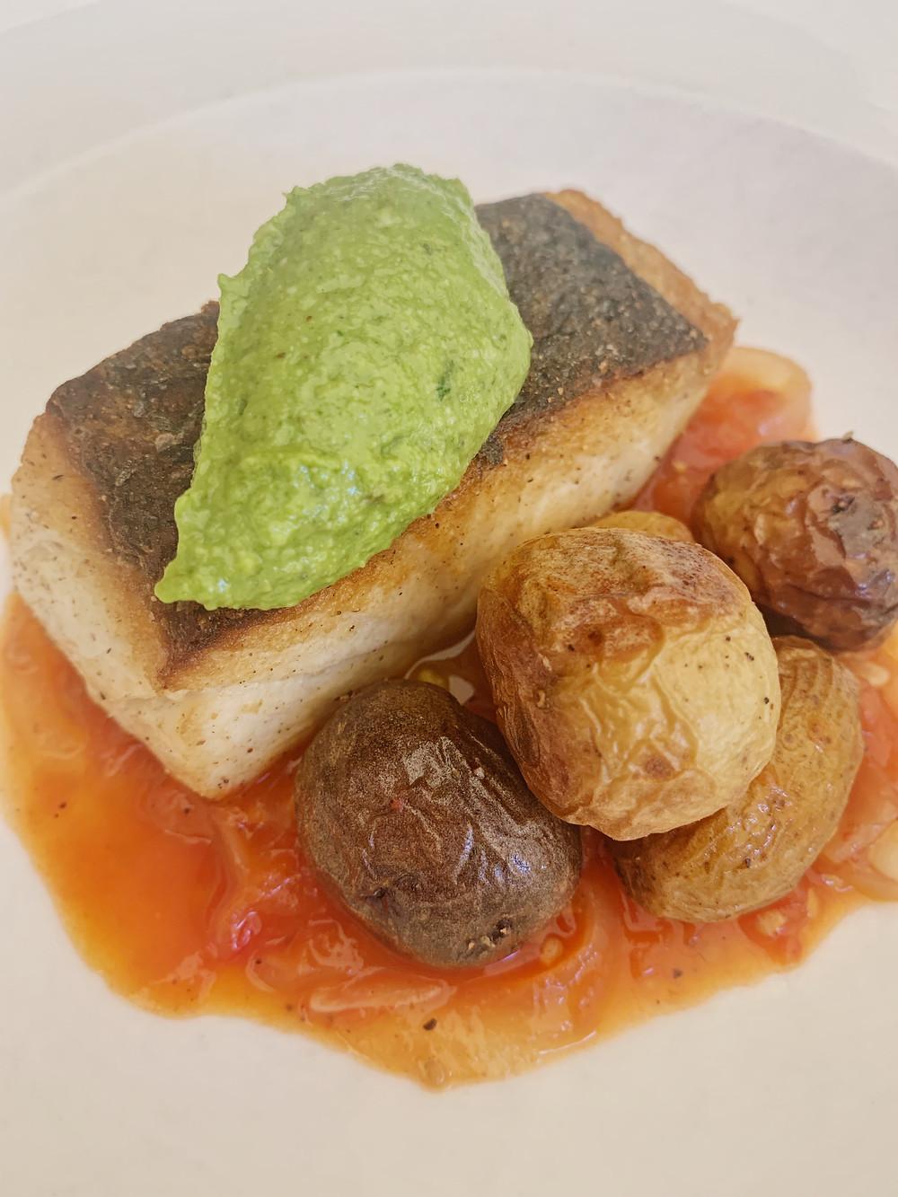 pan-seared white bass roasted heirloom potatoes, stewed tomatoes, basil pesto