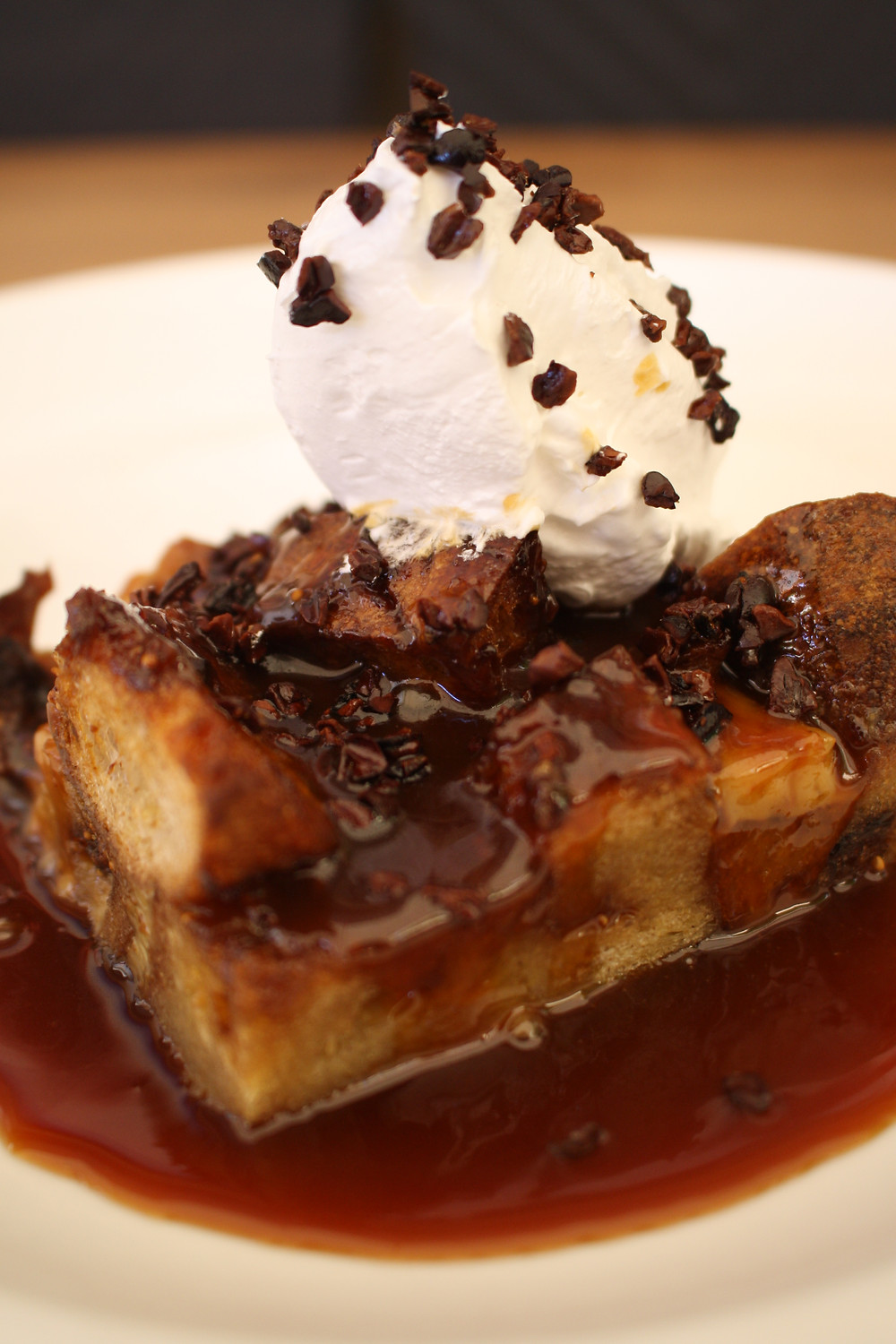 fig bread pudding salted caramel, vanilla chantilly, cocoa nibs