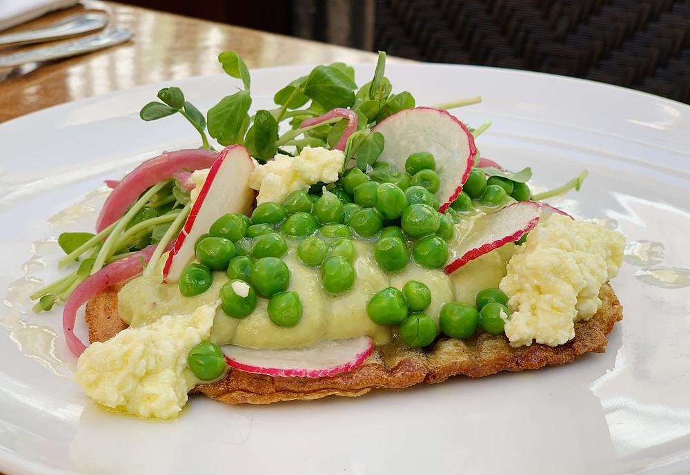 spring pea toast avocado hummus, spring peas, radish, marinated feta, tendrils