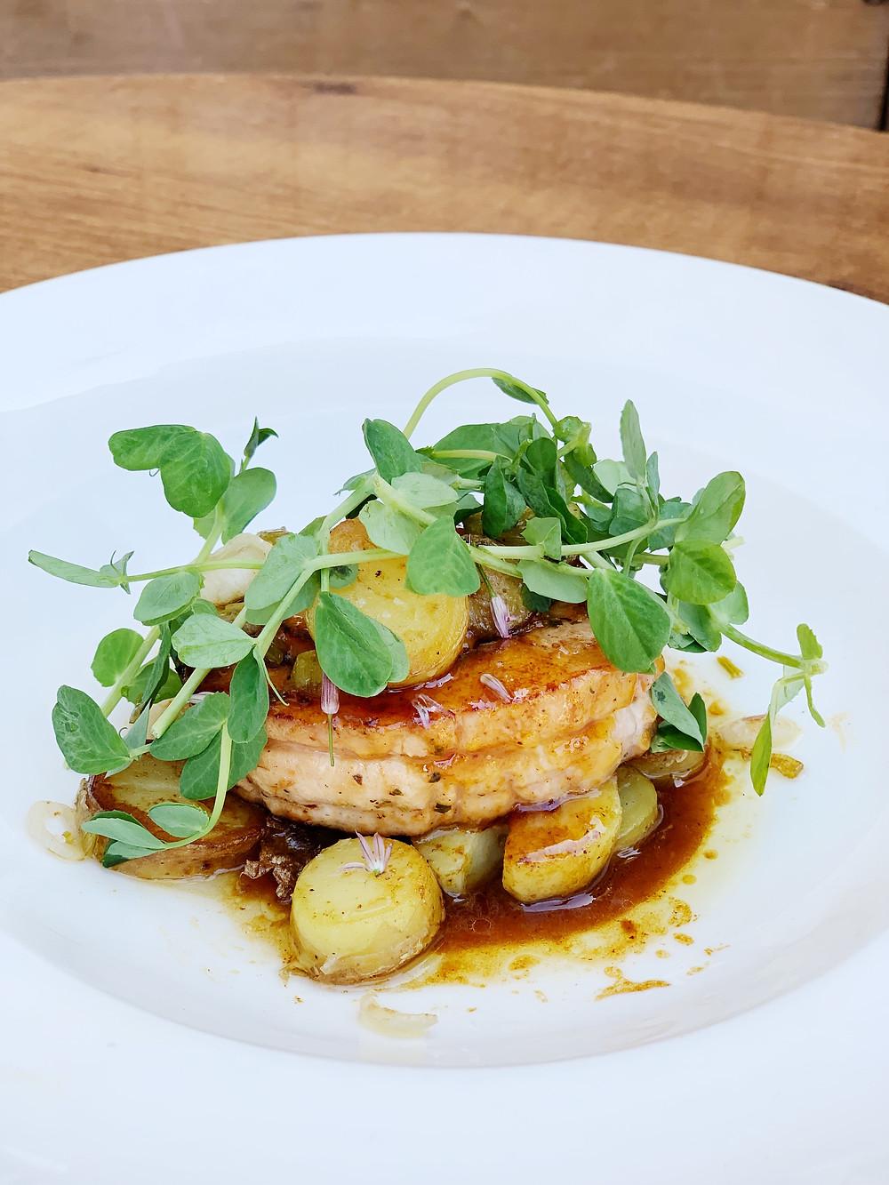 roast pork loin bacon marmalade, spring allium ragoût, fingerling potatoes, apricot glaze