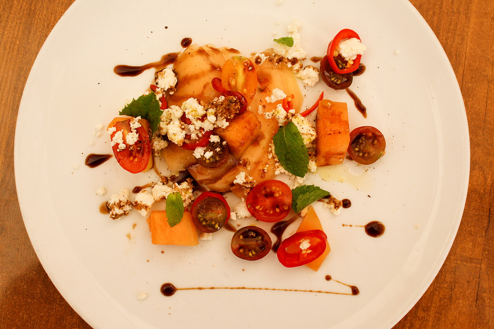 heirloom melon salad toy box tomatoes, french feta, pickled chilies,  barrel aged balsamic