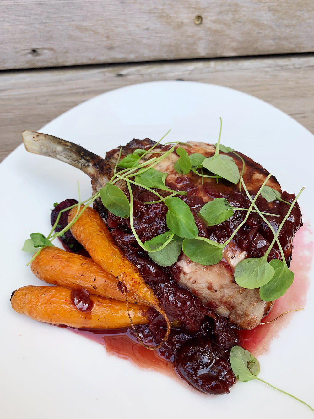 grilled pork chop  roasted carrots & beets, cherry-port reduction