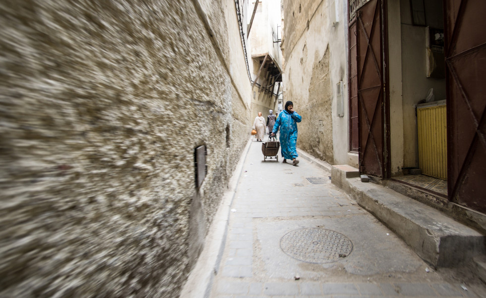 Lady in Fez going to her daily routine in the early morning