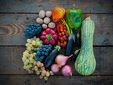 harvested vegetables on wood table - Photo Credit: Dan-Cristian Pădureț via Unsplash
