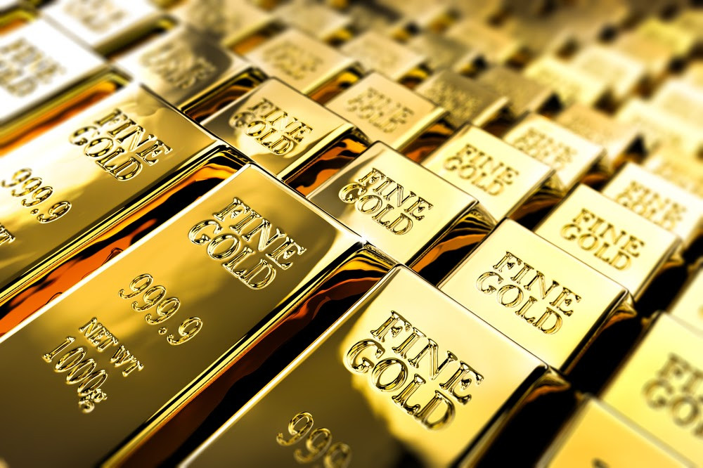 Large gold bars lie stacked on one another.