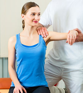 Assesing a shoulder injury at The Tides Osteopathic Clinic Swansea