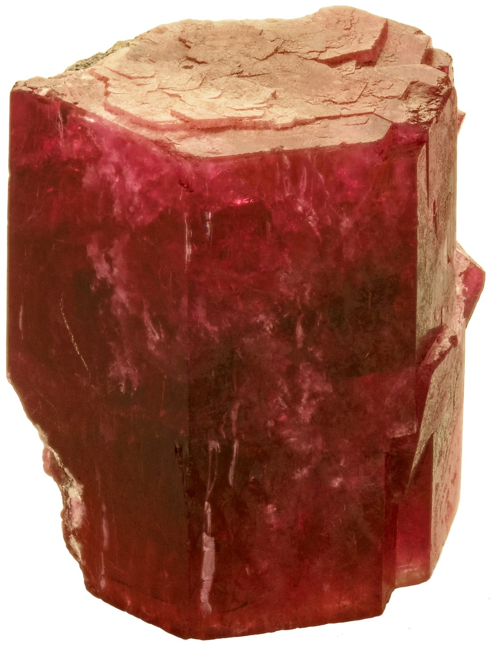 Notched corners on two ends of a Red Beryl Prism