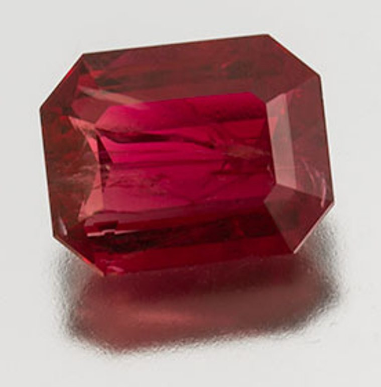 2.44 carat Red Emerald with rehealed spread pattern - Photo by Mia Dixon