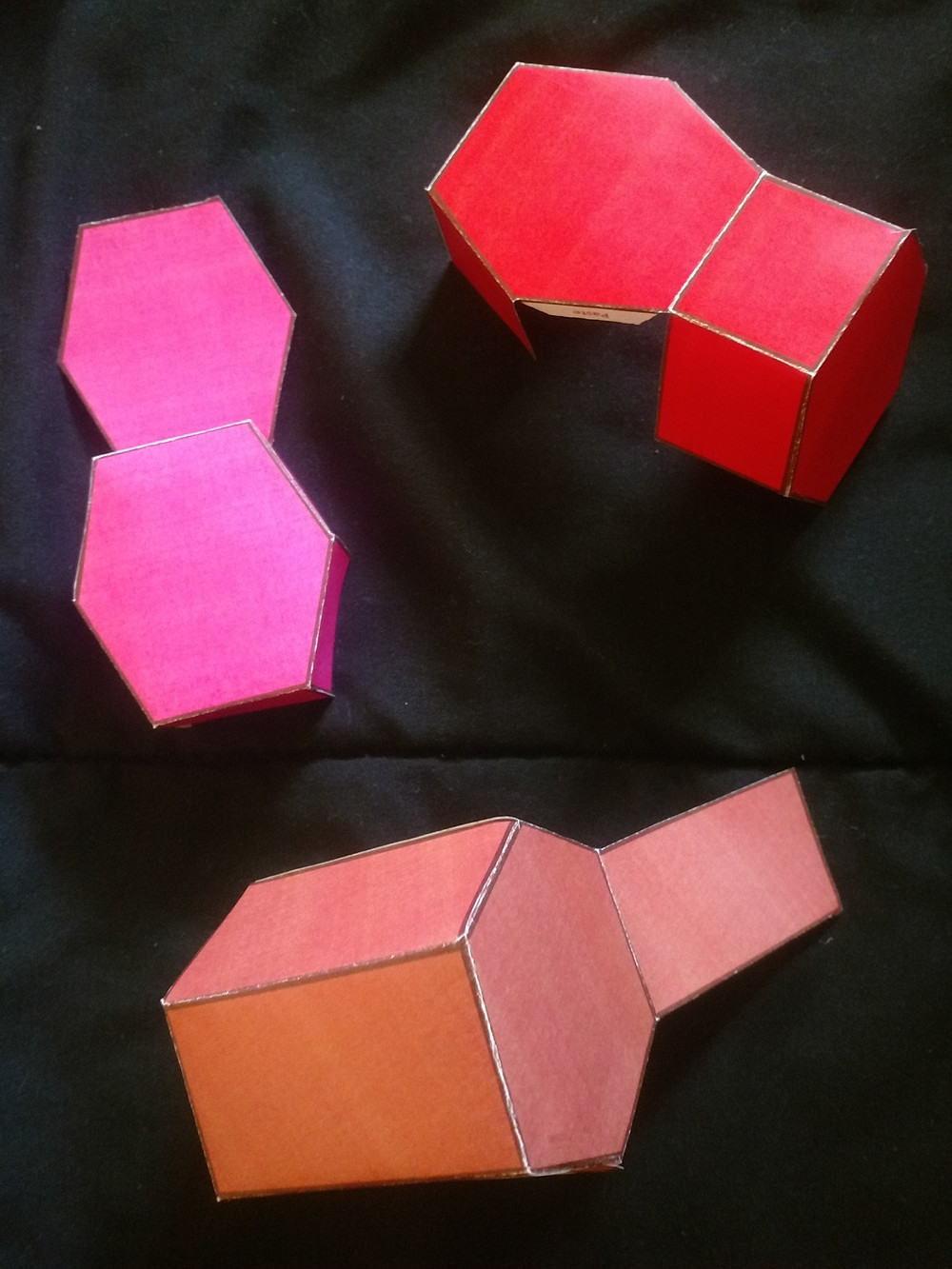 Folded and Bent Red Emerald Paper Models