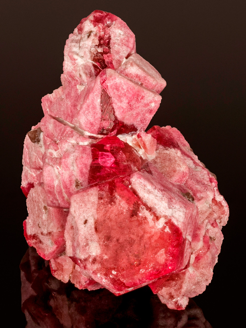 87.65 carat red beryl cluster with gem stripe