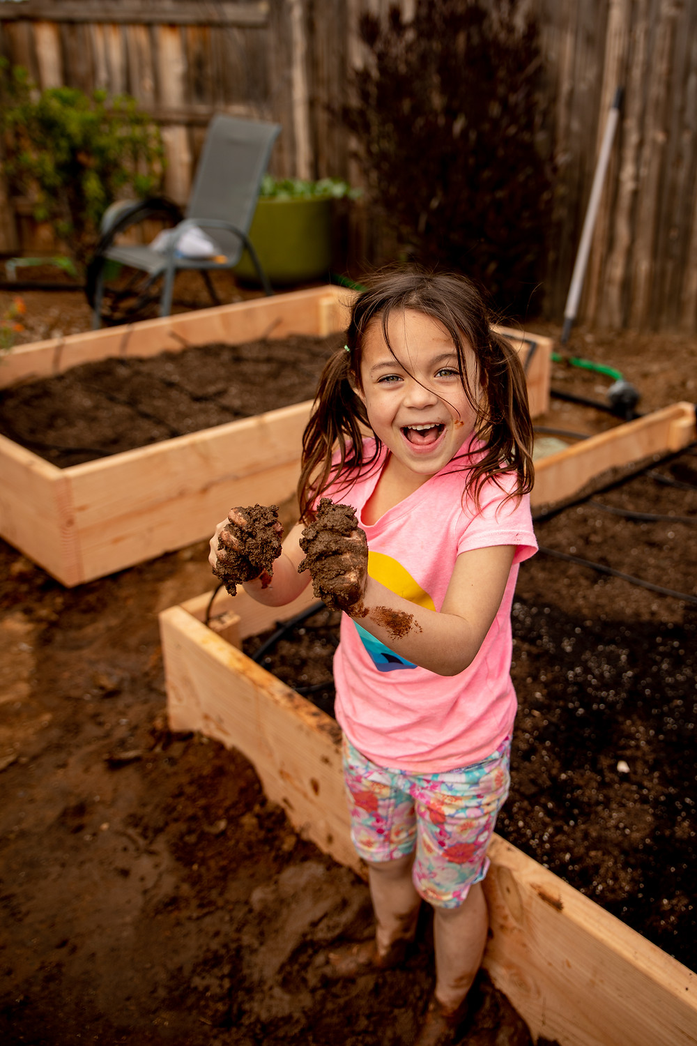 girl happy in the mud