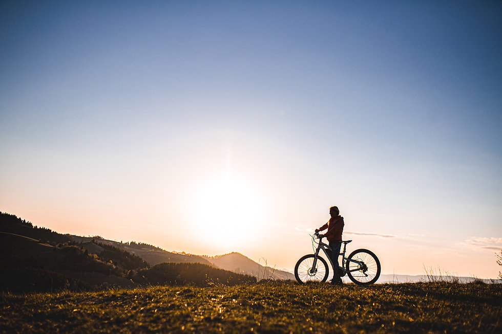 active-senior-woman-with-e-bike-outdoors