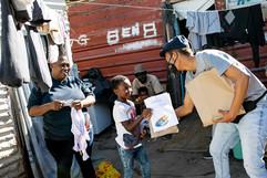 Sir Sikelela handing out art kits.jpg