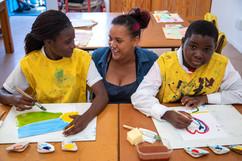 Teacher Courtney teaching art.jpg
