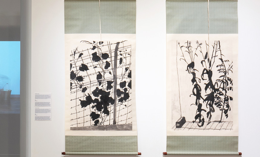 Kim Sundoo (b.1958) Gap 2019 Ink on paper  Ivy 2019 Ink on paper  The only ink paintings in the exhibition, these works appear traditional in their ink monochrome medium. Microcosmic depictions of plant life are rooted in East Asian literati painting tradition in which specific types of flora or fauna carry symbolic meaning. Despite their traditional medium and style, Gap and Ivy are glimpses of modern life. Kim participated in the Candlelight protests and created these works later in his studio. The growth of the plant life—weeds rising through the concrete and ivy climbing over a metal fence—symbolizes the resilience of the human spirit and ideas.