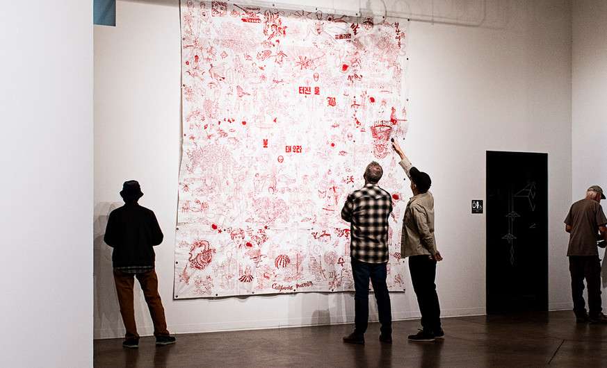"""Ma C (b.1961) Pattern 2015 Embroidery on plastic tarp  With references to the geopolitical network that underlies the vibrant South Korean economy and popular culture, Ma C often uses soybean export bags from China and the United States as the ground for his hand-stitched works. Pattern is a visually impactful tapestry of fragmented forms from global and Korean popular culture—images that are grounded in everyday life and street culture rather than elite culture. In the large-scale Red Graphic 2, we see a jumble of painted and stitched images extracted from popular and political cultures of East Asia and the west. In Red Graphic 5, we see a Korean door god fusing with the portrait of North Korean dictator Kim Jong-il. In both works, we also see sewn-in shopping and bank receipts, and in Red Graphic 5, the English words """"To Korea."""""""
