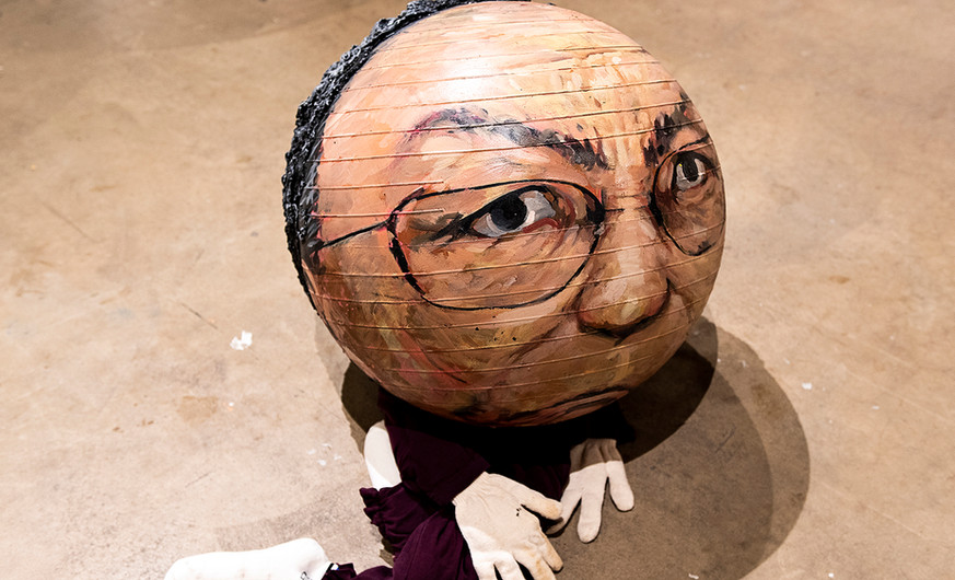 """Lim Oksang (b.1950) Balls  2017 Mixed media  """"From the standpoint of the people, it is clear that political power is a toy."""" – Lim Oksang  Lim Oksang made spherical caricatures of President Park Geun-hye and others political figures, both Korean and foreign, as """"toys"""" for the public to kick during the Candlelight Revolution. Three ball representing Donald Trump, Xi Jinping, and xxxx (?) were created for this exhibition."""