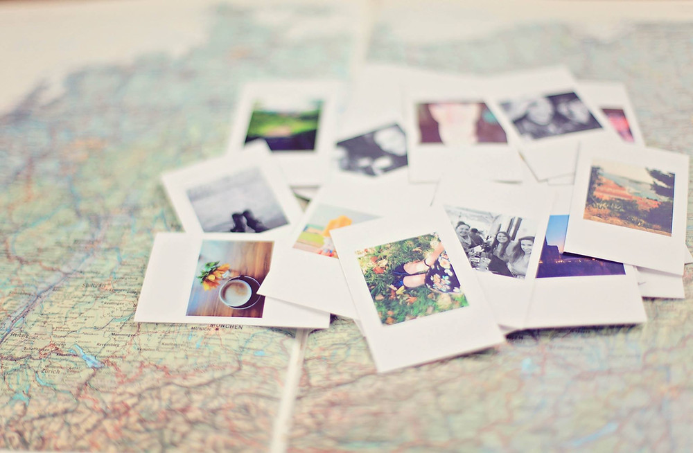 travel polaroids on a map
