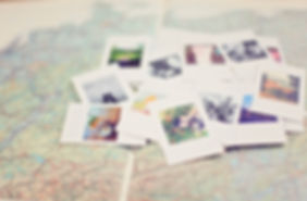 map, photos of travels, polaroids